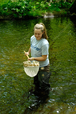 Teenage student testing water quality