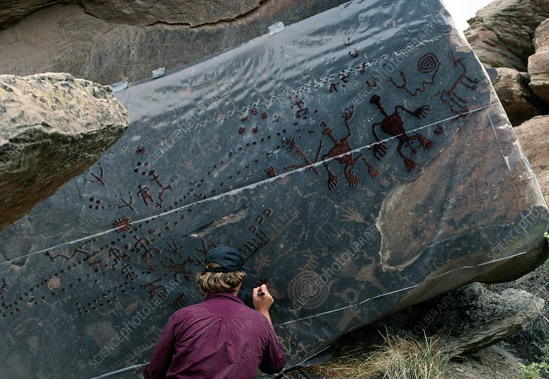 Archaeologists tracing petroglyphs onto plastic