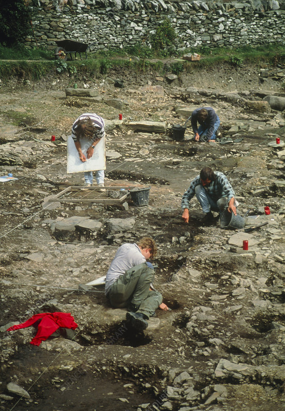 Archaeologists excavate a medieval graveyard