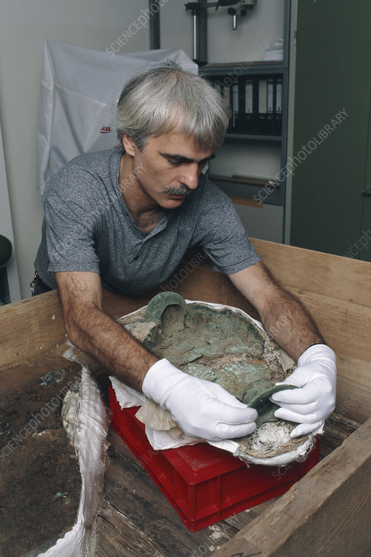 Archaeologist reconstructing a bronze Celtic pot