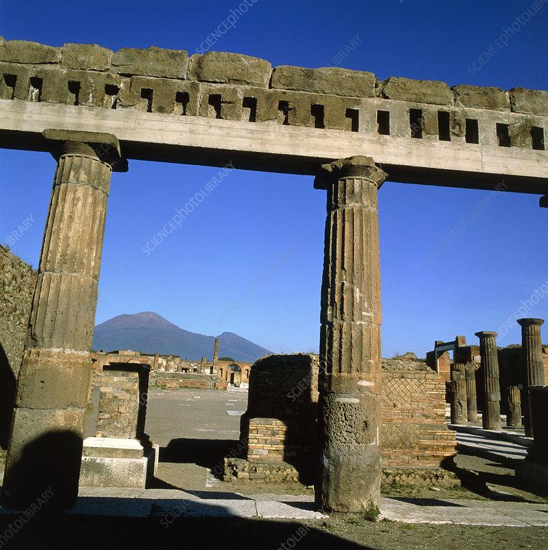 View of Mount Vesuvius through Pompeii ruins