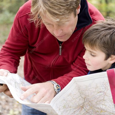 Father and son reading a map
