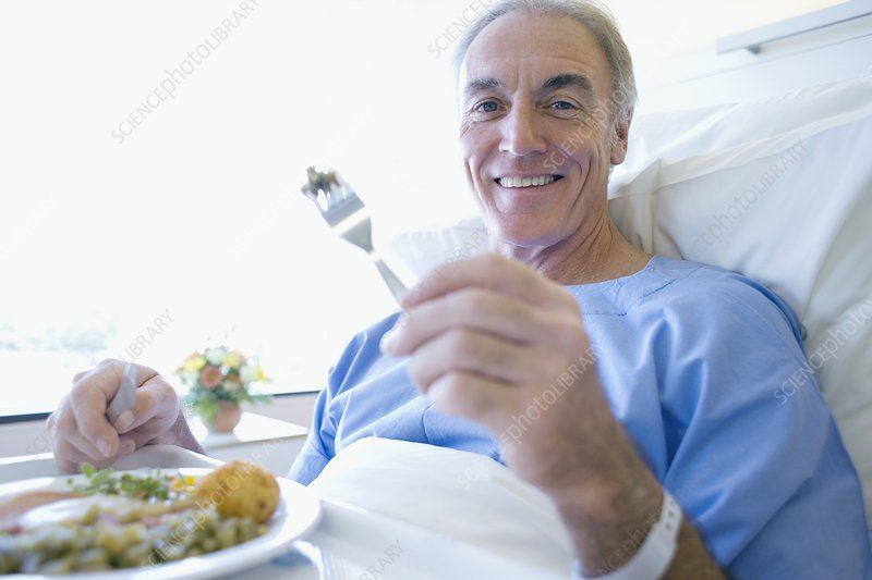 Senior patient eating a hospital meal
