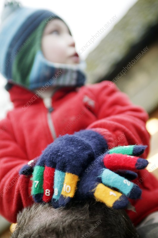 Child wearing gloves