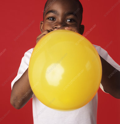Blowing up a balloon