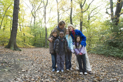 Parents and children in a wood