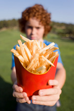Boy holding chips