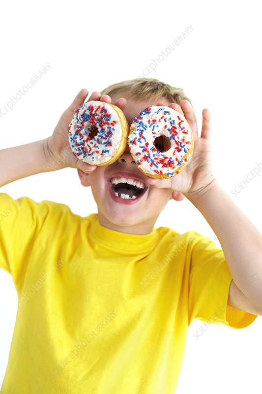 Boy playing with doughnuts