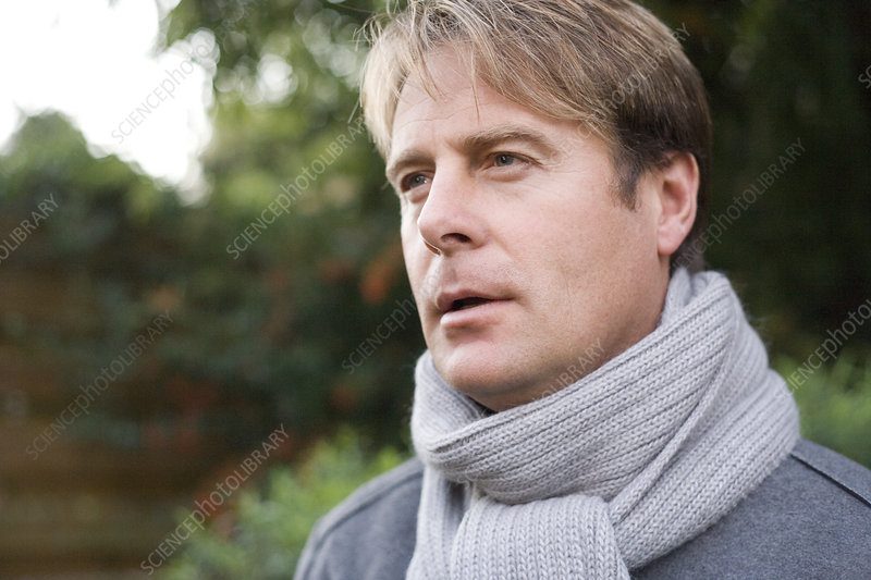 Man wearing a scarf outdoors