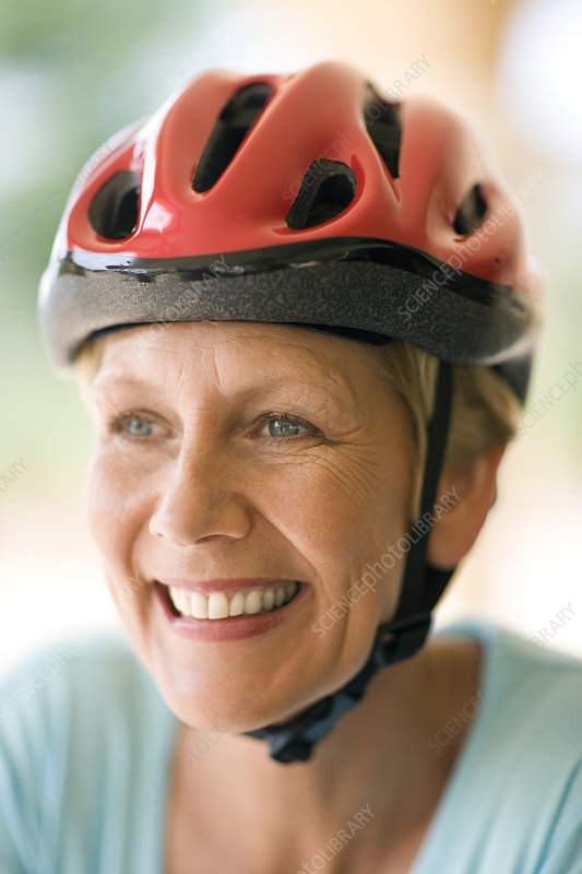 Cyclist wearing a helmet