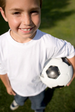 Boy holding a football