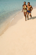 Couple jogging along a beach