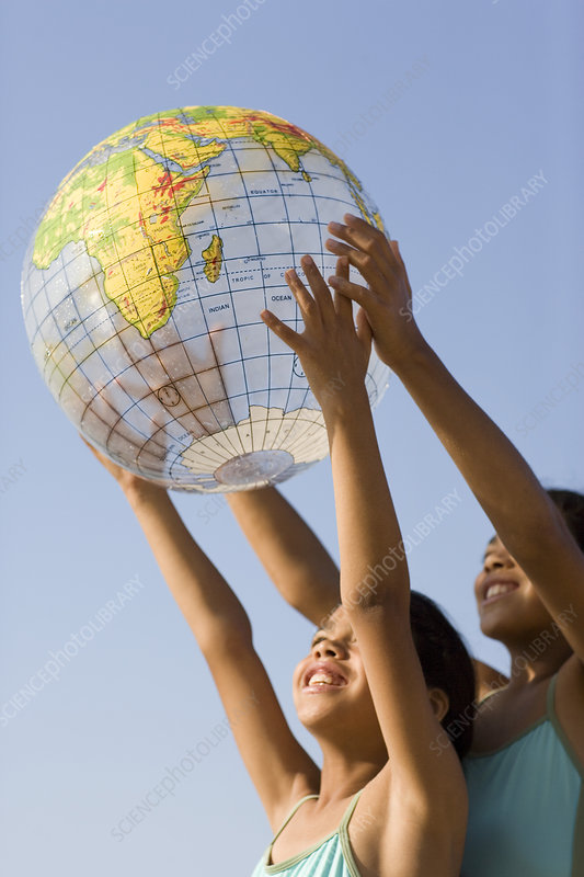 Girls holding an inflated globe