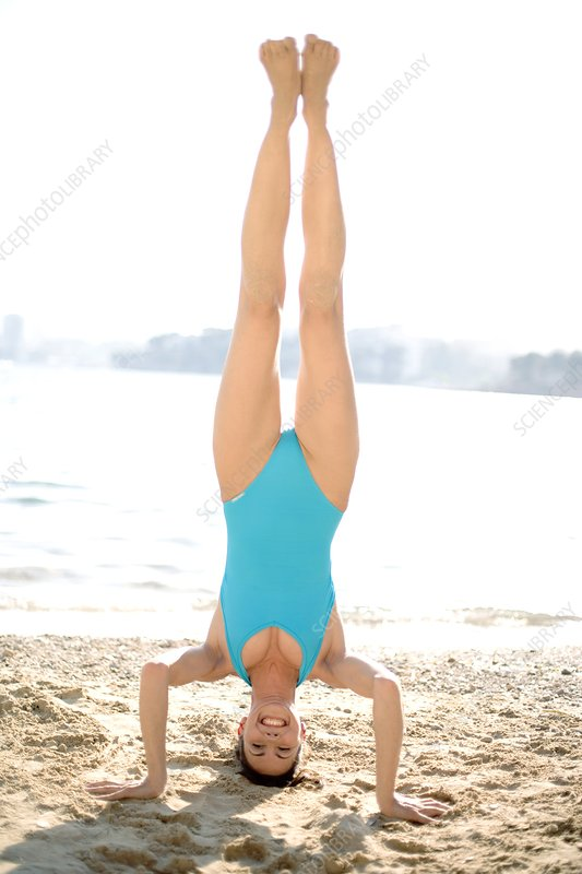 Woman doing a headstand