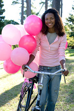 Woman with a bicycle and balloons