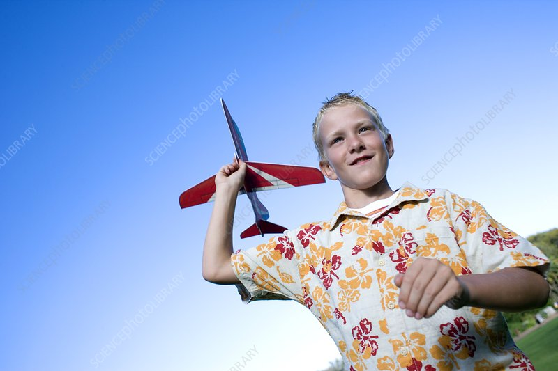 Boy playing with a model aeroplane