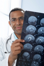 Doctor holding MRI scans
