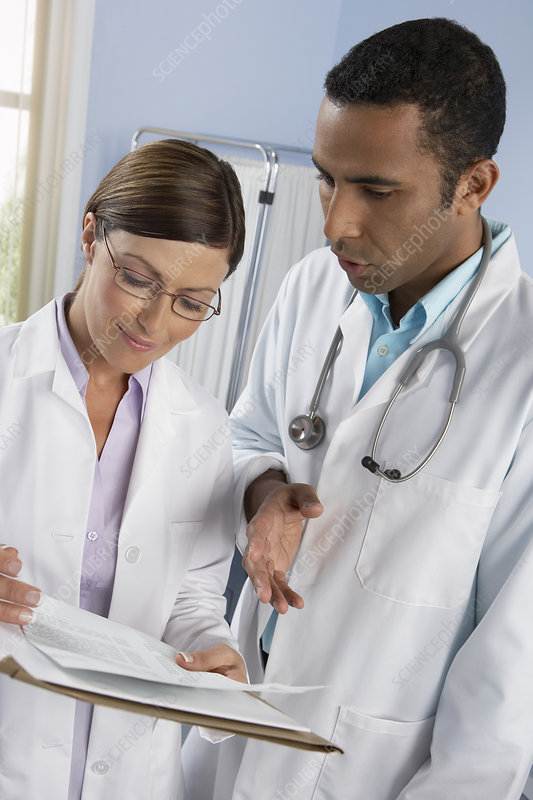 Doctors discussing medical records
