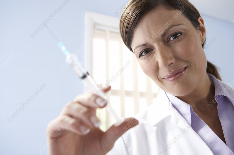 Doctor preparing an injection