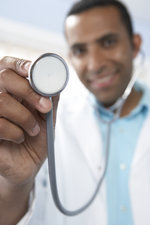 Doctor using a stethoscope