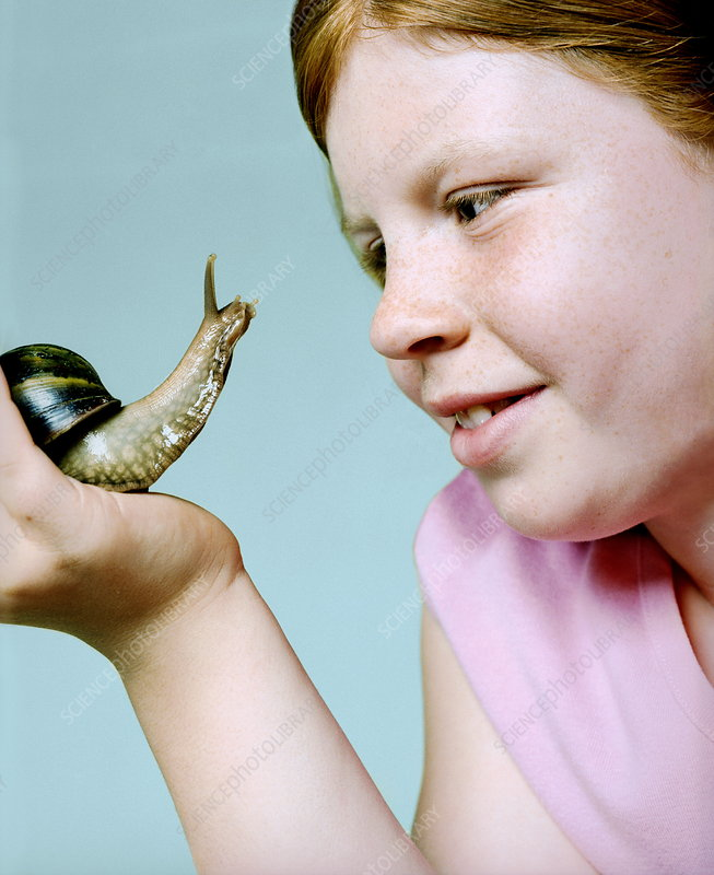Girl holding a giant snail