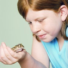 Girl with her pet toad
