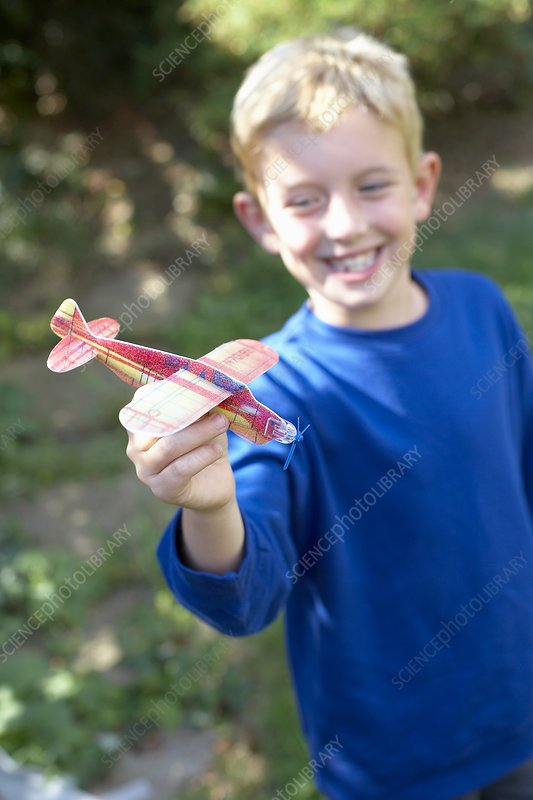 Boy playing with a toy aeroplane