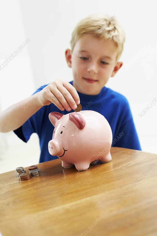 Child with a piggy bank