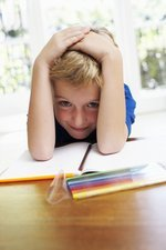 Boy with pens and exercise book