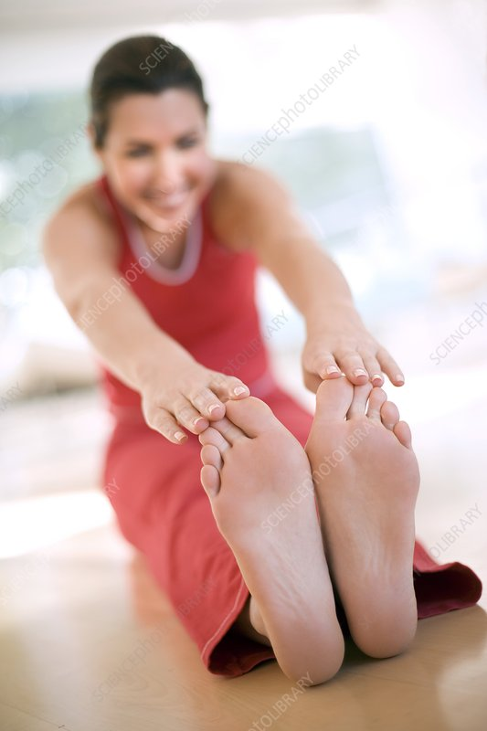 Woman touching her toes