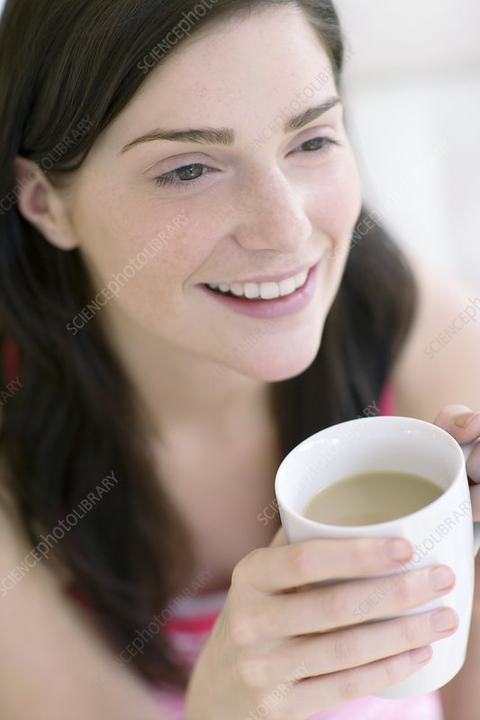 Woman holding a hot drink