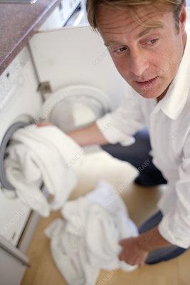 boy wash clothes man washing clothes