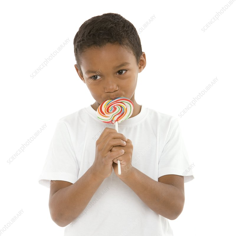 Boy eating a lollipop