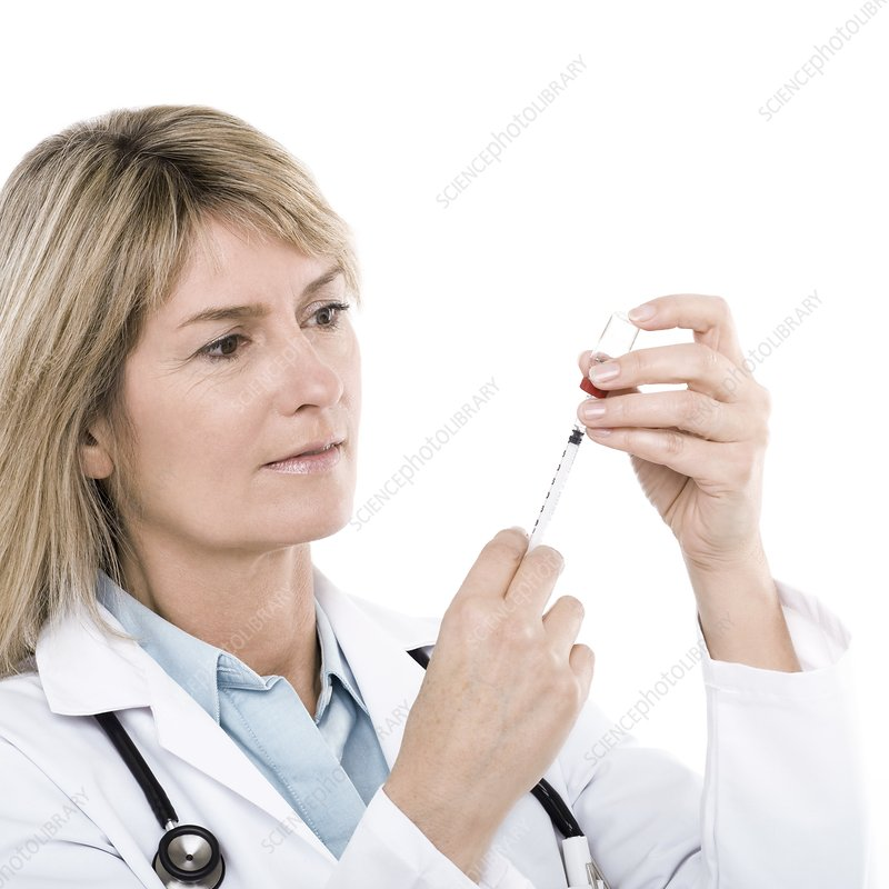 Doctor preparing a syringe