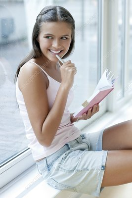 Teenage girl and her diary