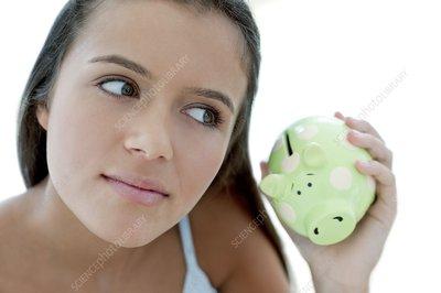 Teenage girl saving money