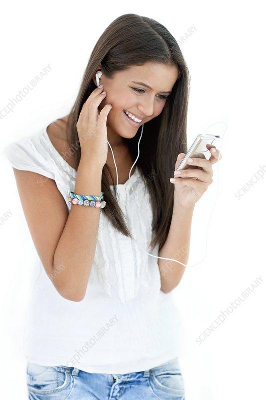 Teenage girl listening to music
