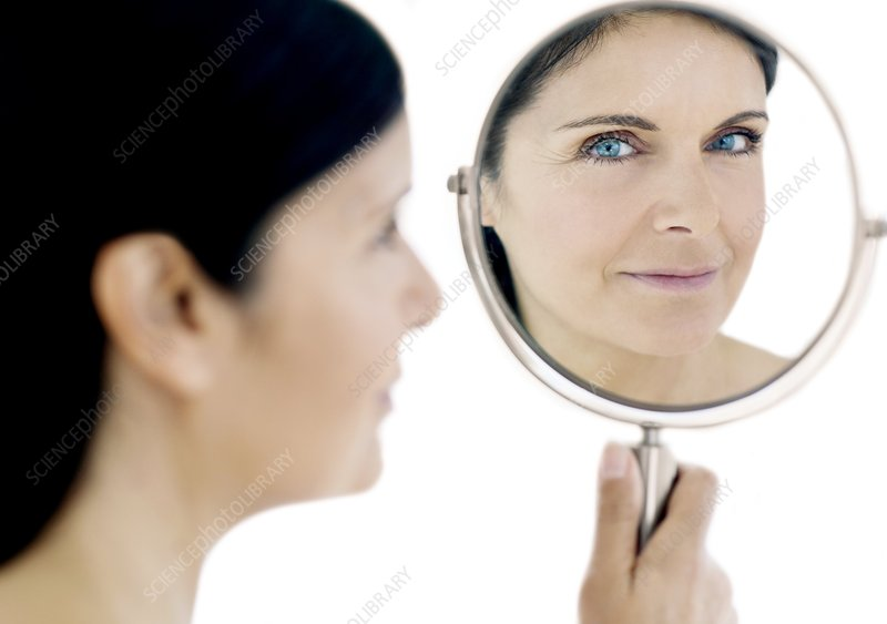 Woman checking for wrinkles