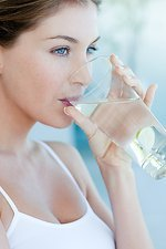 Woman drinking water with lime