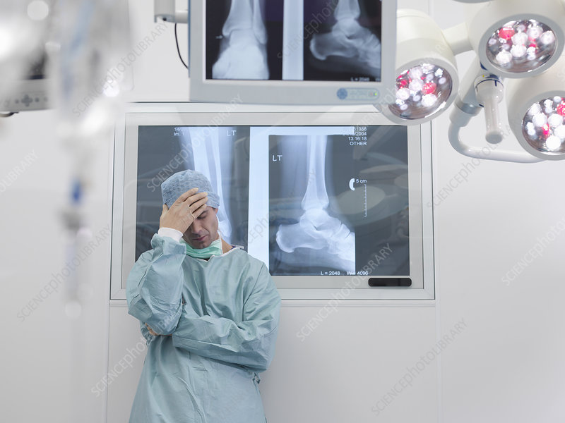 Stressed surgeon in operating theatre - Stock Image F003 ...
