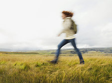 Female Hiker Walking in Open Landscape