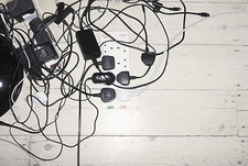 Tangled mess of power leads and chargers