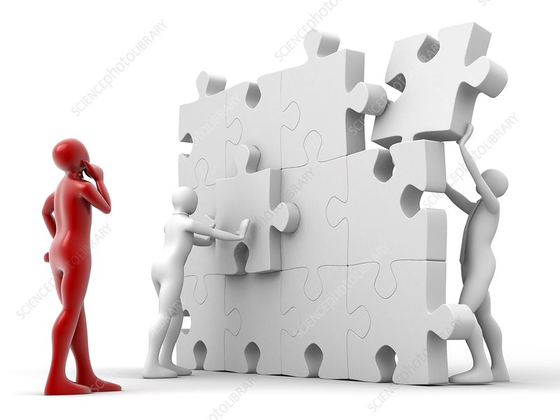 Men putting puzzle pieces together