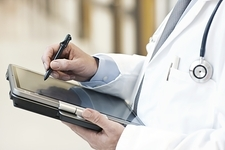 Doctor using a tablet PC