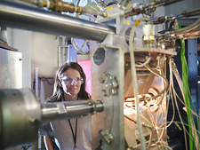 Scientist inspects particle accelerator
