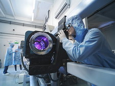 Scientist checking laser in laboratory