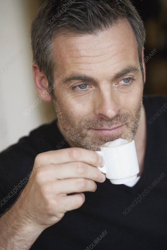 Man having espresso
