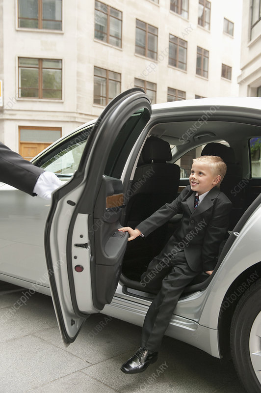 Young Businessman Exiting Car