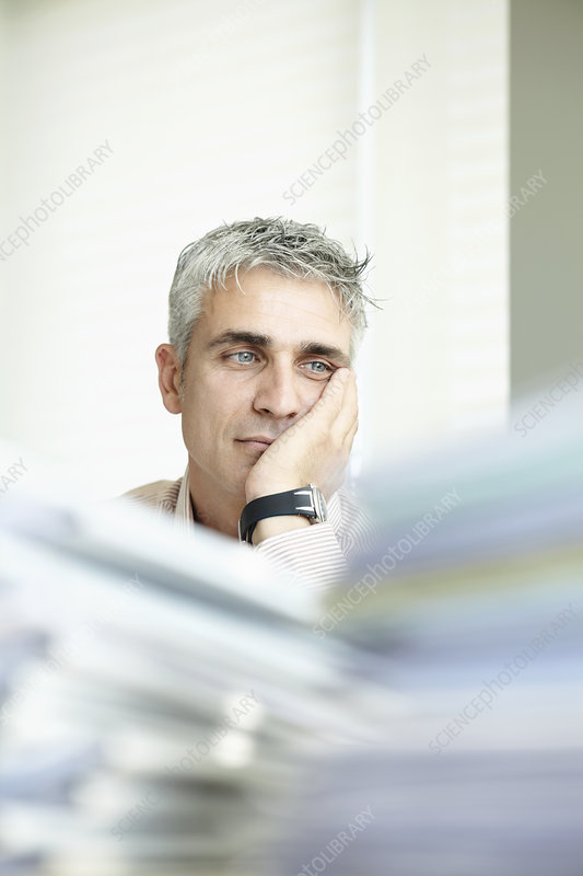 Exhausted man with paperwork