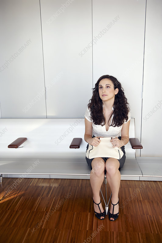 Young woman in waiting room